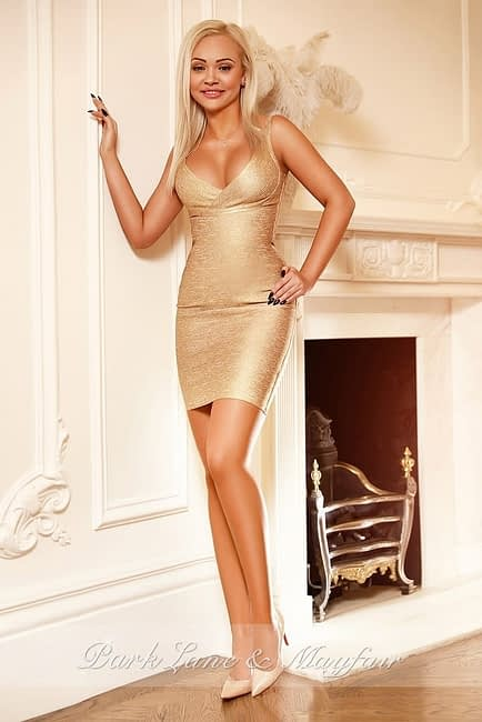 Elite escort Ursula in her elegant gold dress